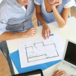 Couple meeting architect for plans of future home — Stock Photo #13964935