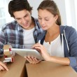 Couple packing stuff to move in new apartment - Stock Photo