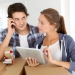 Couple calling transport company to move in new house — ストック写真