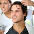 Stock Photo: Hairdresser applying hair gel