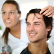 Hairdresser applying hair gel — Stock Photo