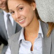 Closeup of businesswoman with in background — Stock Photo