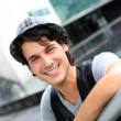 Royalty-Free Stock Photo: Portrait of cheerful young man standing in street