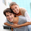 Man giving piggyback ride to girlfriend — Stock Photo #13965480