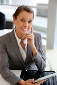Businesswoman using electronic tablet — Stock Photo