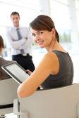 Businesswoman attending business presentation — Stock Photo