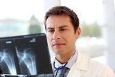 Doctor checking on patient Xray results — Stock Photo