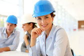 Portrait of attractive architect wearing security helmet — Stock Photo