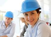 Portrait of attractive architect wearing security helmet — Stock Photo