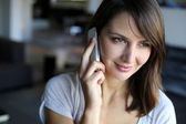 Portrait of attractive woman talking on mobile phone — Stock Photo