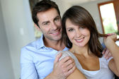Portrait of married couple at home — Stok fotoğraf