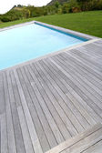 Closeup of private pool and wood deck — Stock Photo