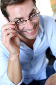 Smiling man with eyeglasses on — Stock Photo