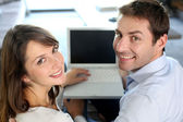 Upper view of smiling couple using laptop computer — Stock Photo