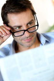 Man with eyeglasses reading newspaper — Stock Photo