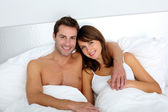 Portrait of lovers embracing each other in bed — Stock Photo