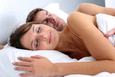 Closeup of couple sleeping in bed — Stock Photo