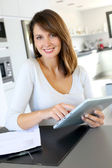Beautiful teleworker working from home — Stock Photo