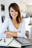 Beautiful teleworker working from home — Stok fotoğraf