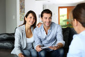 Couple meeting architect for plans of future home — Foto Stock
