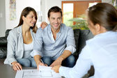 Couple signing financial terms for future property — Stockfoto