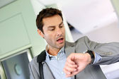 Businessman running late for work — Stock Photo