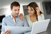 Couple looking at future home blueprint — Stock Photo