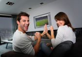 Couple having fun watching soccer game — Stok fotoğraf