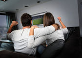 Couple having fun watching soccer game — Stock fotografie