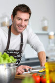 Man in kitchen preparing dinner — Stock Photo