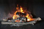 Closeup of wood burning in fireplace — Stock Photo