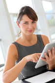 Businesswoman being scared while looking at tablet — Stock Photo