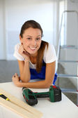 Smiling woman ready to redo home — Stock Photo