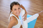 Beautiful woman exercising in gym — Stock Photo