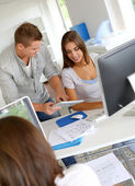 Young working in office with digital tablet — Stock Photo