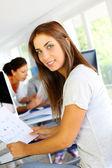 Beautiful office worker sitting in front of desktop — Stock Photo