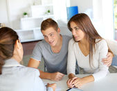 Young couple meeting financial consultant for credit loan — Stock Photo