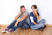 Young couple talking on mobile phone — Stock Photo