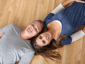 Upper view of young couple laying on the floor — Stock Photo