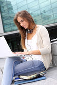 Young girl at university using laptop computer — Stock Photo