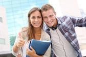 Happy students at university campus — Stock Photo