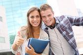 Happy students at university campus — Stock Photo