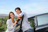 Young couple on a week-end trip in car — Stock Photo