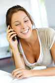 Cheerful young woman talking on the phone — Stock Photo