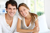 Portrait of smiling young couple at home — Stock Photo