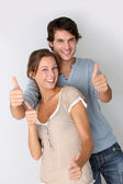 Cheerful couple showing thumbs up, isolated — Stock Photo