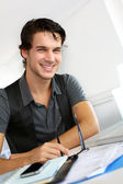 Portrait of young man working in office — Stock Photo