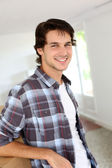 Young man packing boxes to move in new flat — Stock Photo