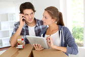 Couple calling transport company to move in new house — Stock Photo