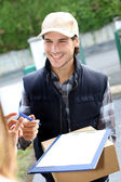 Portrait of smiling delivery man — Stock Photo